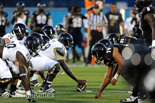 30 March 2012:  FIU's offensive and defense lines wait for the snap at the FIU Football Spring Game at University Park Stadium in Miami, Florida.