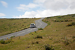 Car driving over moorland near Haytor, Dartmoor national park, Devon, England, UK