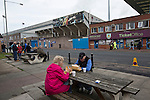 Burnley 1 West Ham United 3, 18/10/2014. Turf Moor, Premier League. Home supporters eating fish and chips near Turf Moor, home of Burnley FC, before the club hosted West Ham United in an English Premier League match. The fixture was won by the visitors by three goals to one watched by 18,936 spectators. The defeat meant that Burnley still had not won a league match since being promoted from the Championship the previous season. Photo by Colin McPherson.