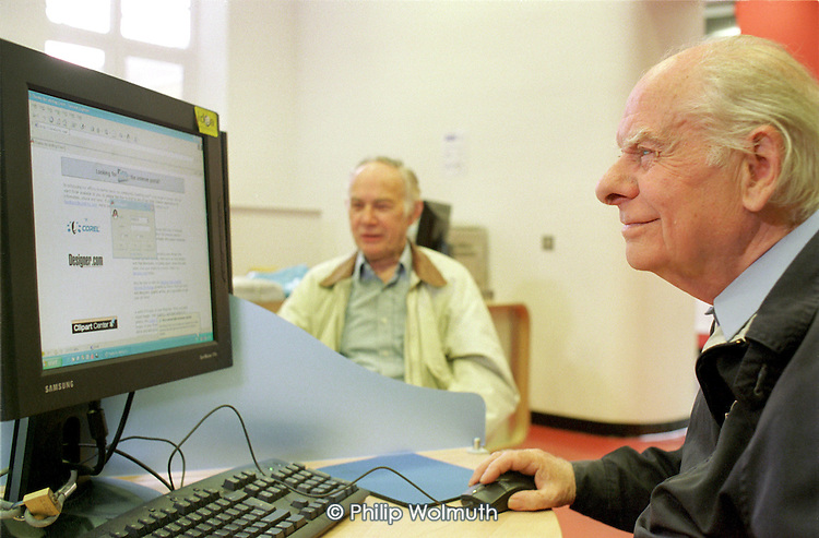Tom Crouch and Norman Mayers use new computers in the Bow IDEA Store, Tower Hamlets.