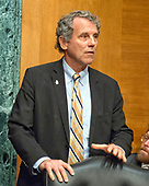"""United States Senator Sherrod Brown (Democrat of Ohio) arrives to hear Richard F. Smith, former Chairman and Chief Executive Officer, Equifax, Inc. give testimony before the US Senate Committee on Banking, Housing, and Urban Affairs as they conduct a hearing entitled, """"An Examination of the Equifax Cybersecurity Breach"""" on Capitol Hill in Washington, DC on Tuesday, October 3, 2017. <br /> Credit: Ron Sachs / CNP"""