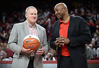 NWA Democrat-Gazette/ANDY SHUPE<br /> Arkansas athletics director Hunter Yurachek (left) presents Razorback great Sydney Moncrief with a ceremonial basketball during a time out against LSU Friday, Jan. 11, 2019, during the first half of play in Bud Walton Arena in Fayetteville. Visit nwadg.com/photos to see more photographs from the game.