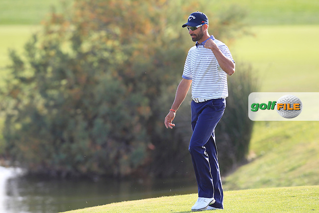 Alvaro Quiros (ESP) walks to the 17th green during Saturday's Round 3 of the 2013 Portugal Masters held at the Oceanico Victoria Golf Club. 12th October 2013.<br /> Picture: Eoin Clarke www.golffile.ie