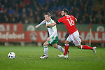 Steven Davis of Northern Ireland and Joe Ledley of Wales during the international friendly match at the Cardiff City Stadium. Photo credit should read: Philip Oldham/Sportimage