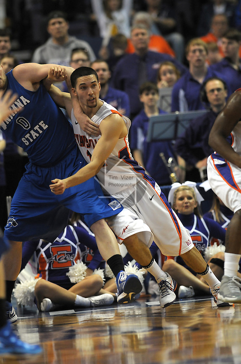Evansville Aces guard/forward Colt Ryan (11) pushes into Indiana State Sycamores forward Jake Kitchell (0) in the second quarterfinal game of the Missouri Valley Conference Tournament. The University of Evansville Purple Aces played against the Indiana State University Sycamores on Friday March 8, 2013 at the Scottrade Center in St. Louis, Missouri.