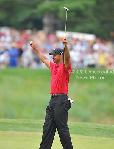 Bethesda, MD - July 5, 2009 -- Tiger Woods celebrates his victory after putting out on the 18th hole at the AT&T National Hosted by Tiger Woods at Congressional Country Club in Bethesda, Maryland on Sunday, July 5, 2009.  Woods won the tournament by 1 stroke over Hunter Mahan..Credit: Ron Sachs / CNP