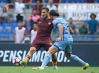 Calcio, Serie A: Roma vs Sampdoria. Roma, stadio Olimpico, 11 settembre 2016.<br /> Roma&rsquo;s Francesco Totti, left, is challenged by Sampdoria&rsquo;s Matias Silvestre during the Italian Serie A football match between Roma and Sampdoria at Rome's Olympic stadium, 11 September 2016. Roma won 3-2.<br /> UPDATE IMAGES PRESS/Isabella Bonotto