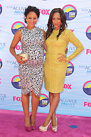 UNIVERSAL CITY, CA - JULY 22: Tamera Mowry and Tia Mowry at the 2012 Teen Choice Awards at Gibson Amphitheatre on July 22, 2012 in Universal City, California. &copy; mpi28/MediaPunch Inc. /NortePhoto.com*<br />