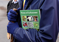 """NWA Democrat-Gazette/FLIP PUTTHOFF<br />""""Trees of Arkansas"""" field guide, publshed by the Arkansas Forestry Commission, is a great aid     FEb. 17 2018    for identifying trees during any season, said hike leaders Cris and Eleanor Jones."""