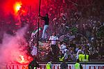 Stockholm 2013-06-23 Fotboll Superettan , Hammarby IF - &Auml;ngelholms FF :  <br /> Hammarby Bajen supporter har kl&auml;ttrat upp p&aring; en st&aring;ng p&aring; Norra l&auml;ktaren samtidigt som Hammarby Bajen fans eldar bengaliska eldar under den sista matchen p&aring; S&ouml;derstadion<br /> (Foto: Kenta J&ouml;nsson) Nyckelord:  supporter fans publik supporters