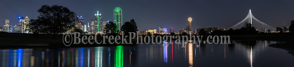 Another capture zoomed in of this wonderful city along the Trinity River. Dallas skyline reflections pano in downtown. This image of the Dallas Cityscape includes the Margaret Hunt Hill Bridge, the Reunion Tower, Bank of America, Renaissance Tower, and many more of the city's high rises buildings This skyline reflects back into the waters of the Trinity river with the buildings and bridge along with those iconic skycrapers reflections in the water of the Trinity.