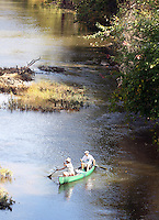 A couple canoes down the Rivanna River in Charlottesville, VA. Photo/Andrew Shurtleff