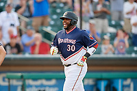 Rochester Red Wings designated hitter Kennys Vargas (30) smiles as he crosses the plate after hitting a home run in the bottom of the fourth inning during a game against the Pawtucket Red Sox on July 4, 2018 at Frontier Field in Rochester, New York.  Pawtucket defeated Rochester 6-5.  (Mike Janes/Four Seam Images)