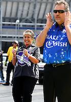 Apr 10, 2015; Las Vegas, NV, USA; NHRA sponsor Terry Chandler (left) during qualifying for the Summitracing.com Nationals at The Strip at Las Vegas Motor Speedway. Mandatory Credit: Mark J. Rebilas-
