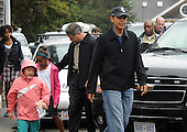 West Tisbury, MA - August 30, 2009 -- United States President Barack Obama, followed by niece Suhaila Ng (2ndL), and daughters Sasha (3rdL) and Malia (far L) exit Alley's General Store after buying snacks August 30, 2009 in West Tisbury, Massachusetts. The president is spending his last day on Martha's Vineyard before returning to Washington later today. .Credit: Darren McCollester / Pool via CNP
