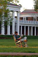 A student reads while sitting in a rocking chair on the lawn at the University of Virginia near the rotunda.  Photo/Andrew Shurtleff