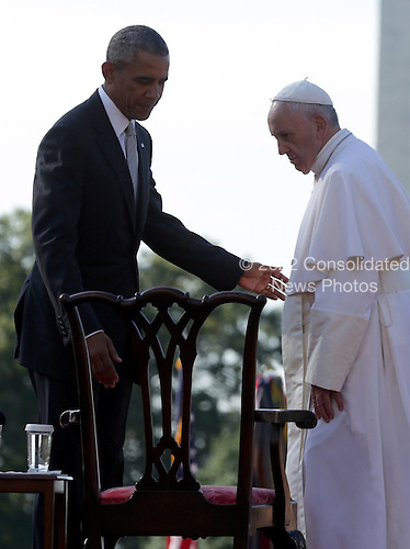 (L-R)  U.S. President Barack Obama guides Pope Francis to his chair during his arrival ceremony at the White House on September 23, 2015 in Washington, DC. The Pope begins his first trip to the United States at the White House followed by a visit to St. Matthew's Cathedral, and will then hold a Mass on the grounds of the Basilica of the National Shrine of the Immaculate Conception.  <br /> Credit: Alex Wong / Pool via CNP