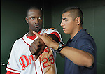 Third baseman Vladimir Frias (29) of the Greenville Drive is worked on in the dugout by trainer David Herrera during a game against the Lakewood BlueClaws on May 13, 2010, at Fluor Field at the West End in Greenville, S.C. Frias was struck on the arm during a play on the field. He remained in the game. Photo by: Tom Priddy/Four Seam Images