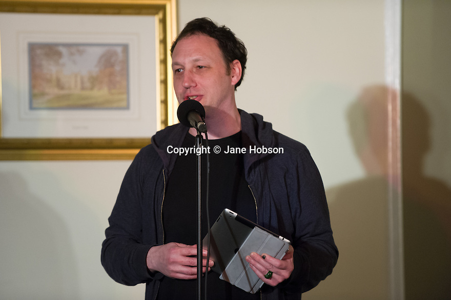 Harrogate, UK. 12/04/2012. Standing room only as Sitting Room comedy, yet again, packs out the function room at the St George Hotel, Harrogate.  Featuring M.C. Tom Taylor, Carey Marx, James Redmond (Abs from Casualty) and Rob Rouse, headlining. Picture shows Carey Marx. Photo credit: Jane Hobson