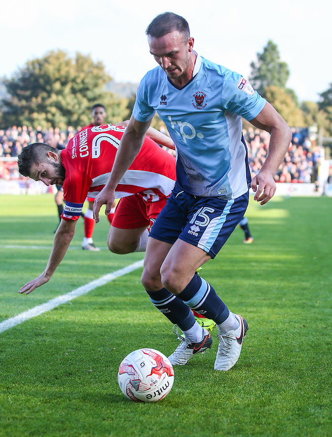 Blackpool's Tom Aldred goes past Accrington Stanley's Seamus Conneely<br /> <br /> Photographer Alex Dodd/CameraSport<br /> <br /> The EFL Sky Bet League Two - Accrington Stanley v Blackpool - Saturday 15th October 2016 - Wham Stadium - Accrington<br /> <br /> World Copyright &copy; 2016 CameraSport. All rights reserved. 43 Linden Ave. Countesthorpe. Leicester. England. LE8 5PG - Tel: +44 (0) 116 277 4147 - admin@camerasport.com - www.camerasport.com