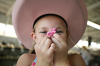 Rachel Denson, 7, of Everson, holds up a toy cow. NW Washington Fair. August 19, 2009 PHOTO BY MERYL SCHENKER.           ....