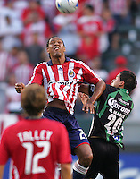 Newly acquired Chivas USA forward Roberto Nurse (20) goes high over Santos defender Osmar Mares (20. Chivas USA defeated the Santos of Laguna 1-0 during the 1st round of the 2008 SuperLiga at Home Depot Center stadium, in Carson, California on Wednesday, July 16, 2008.