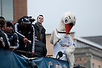 Cyril the swan and Swansea City Football team celebrating during an open-top bus parade through the centre of Swansea after beating Bradford City 5-0 in Sunday's Capital One Cup final at Wembley to win the Capital Cup trophy.