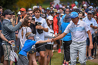 Rickie Fowler (USA) fist bumps a young fan enroute to the tee on 11 during day 3 of the Valero Texas Open, at the TPC San Antonio Oaks Course, San Antonio, Texas, USA. 4/6/2019.<br /> Picture: Golffile | Ken Murray<br /> <br /> <br /> All photo usage must carry mandatory copyright credit (&copy; Golffile | Ken Murray)