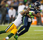 Seattle Seahawks wide receiver blocks Percy Harvin (11) Green Bay Packers safety Morgan Burnett in the NFL Kickoff Game game at CenturyLink Field in Seattle, Washington on September 4, 2014. Harvin caught seven passes for 59 yards, rushed for 41 and returned three kickoffs for 60 yards. The Seahawks pounded the packers 36-16. ©2014  Jim Bryant Photo. ALL RIGHTS RESERVED.