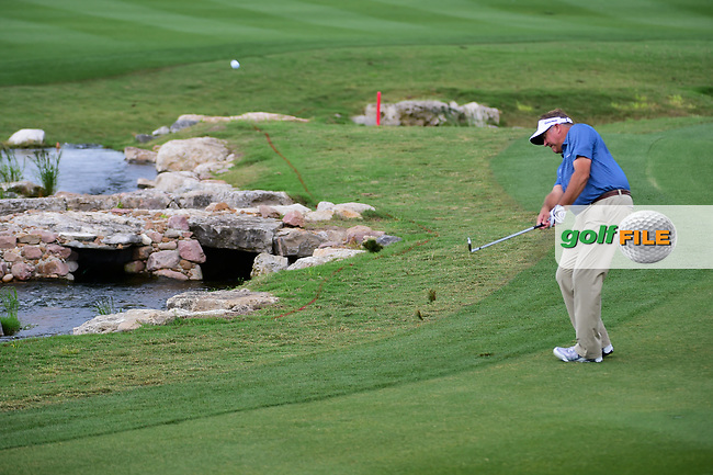 Ken Duke (USA) chips up close on 18 setting up a birdie putt  during round 2 of the Valero Texas Open, AT&amp;T Oaks Course, TPC San Antonio, San Antonio, Texas, USA. 4/21/2017.<br /> Picture: Golffile   Ken Murray<br /> <br /> <br /> All photo usage must carry mandatory copyright credit (&copy; Golffile   Ken Murray)