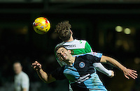Matthew Bloomfield of Wycombe Wanderers goes up for the ball during the Sky Bet League 2 match between Yeovil Town and Wycombe Wanderers at Huish Park, Yeovil, England on 24 November 2015. Photo by Andy Rowland.