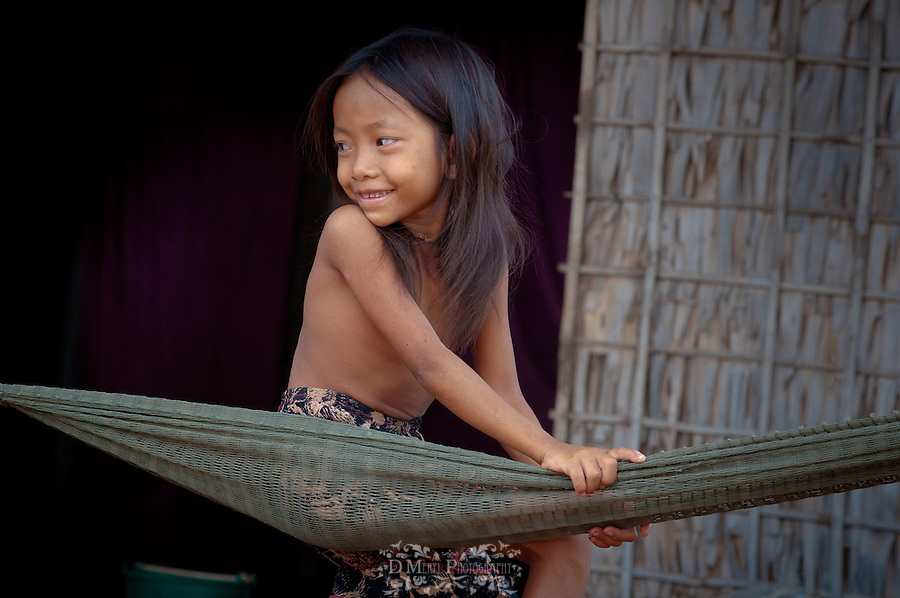 This girl expressed her smile in many ways while I photographed her sitting on this hammock.