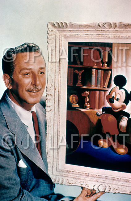 Disney World, Florida - Circa 1986. Walt Disney photographed at the studio with an image of the iconic Mickey Mouse to commemorate the 15th anniversary of the amusement park's opening, courtesy of Walt Disney Productions. He (December 5, 1901 - December 15, 1901) was an American artist, entrepreneur and producer, who became a prominent figure within the American animation industry after he developed the internationally renowned 'Mickey Mouse'.