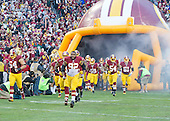 The Washington Redskins, led by Washington Redskins defensive end Chris Baker (92), run onto the field as they are introduced prior to the NFC Wild Card game against the Green Bay Packers at FedEx Field in Landover, Maryland on Sunday, January 10, 2016.<br /> Credit: Ron Sachs / CNP