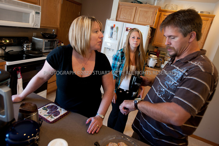 9/5/2011--Ferndale. WA, USA..Heather Lewis, with her husband Steve and step-daughter Nicole,  at their home in Ferndale, WASH., about 2 hours north of Seattle...Heather Lewis, 41, was diagnosed with Sjogrens Sydrome at age 31 - which is young for such a diagnosis. She is a nurse, which probably helped aid her early diagnosis. This summer she was experiencing a pretty bad inflammatory phase of the disease, so she had debilitating fatigue. She is now on methotrexate, a medication to help her manage her symptoms that has strong side effects...©2011 Stuart Isett. All rights reserved.