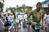 Luke Bell runs through a water station on the run at the 2013 Ironman World Championship in Kailua-Kona, Hawaii on October 12, 2013.