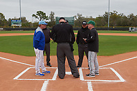 Dartmouth Big Green head coach Bob Whalen during the lineup exchange with Mitch Hannahs (left) before a game against the Indiana State Sycamores on February 21, 2020 at North Charlotte Regional Park in Port Charlotte, Florida.  Indiana State defeated Dartmouth 1-0.  (Mike Janes/Four Seam Images)