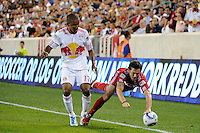 Dan Gargan (3) of the Chicago Fire goes down under pressure from Juan Agudelo (17) of the New York Red Bulls. The New York Red Bulls and the Chicago Fire played to a 2-2 tie during a Major League Soccer (MLS) match at Red Bull Arena in Harrison, NJ, on August 13, 2011.