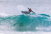 A young local surfer performs an aerial maneuver, Sequence #1, Po'ipu Beach Park, Kaua'i.