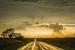 Sun setting after thunderstorm break-up<br /> <br /> Rain slicked SR 41, southern Nebraska