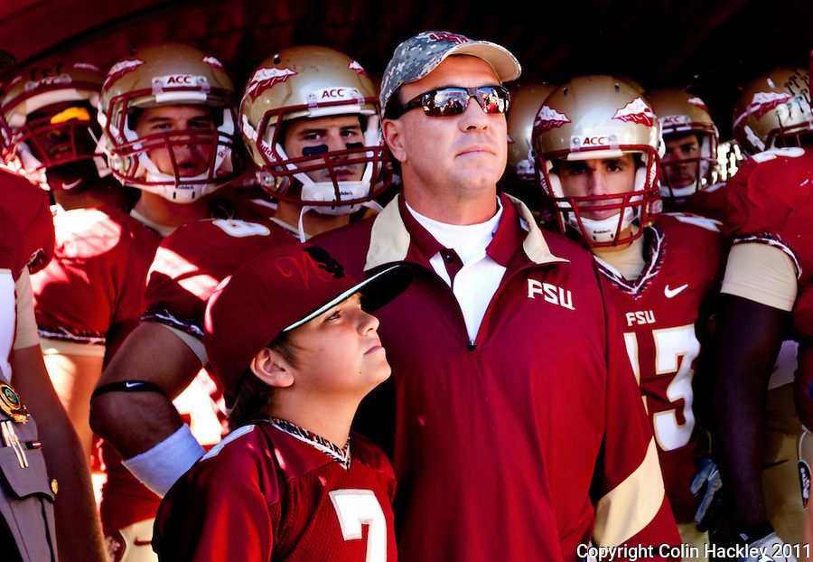 TALLAHASSEE, FL 10/22/11-FSU-MARY102211 CH-Florida State Head Coach Jimbo Fisher, son Trey and the Seminoles prepare to take the field prior to the Maryland game Saturday at Doak Campbell Stadium in Tallahassee. .COLIN HACKLEY PHOTO