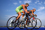 PUERTO VALLARTA, MEXICO - OCTOBER 23:  Michelle Flipo of Mexico and Favia Diaz of Chile on their bike during the Women's  Triathlon competition on Day Eight of the XVI Pan American Games on October 23, 2011 in Puerto Vallarta, Mexico.  (Photo by Donald Miralle for Mexsport) *** Local Caption ***