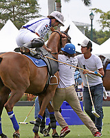 WELLINGTON, FL - MARCH 26:  Valiente's Diego Cavanagh changes horses during the chukker. Scenes from the final of the 26 goal USPA Gold Cup Final,  at the International Polo Club, Palm Beach on March 26, 2017 in Wellington, Florida. (Photo by Liz Lamont/Eclipse Sportswire/Getty Images)