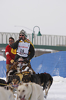 Saturday March 6 , 2010    John Stewart makes his way on the trail alongside Tudor road after crossing the Tudor Road bridge     during the ceremonial start of the 2010 Iditarod in Anchorage , Alaska