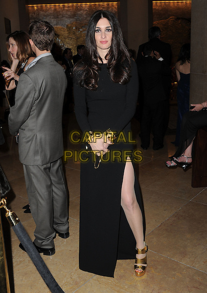 Paz Vega.Exiting The 70th Annual Golden Globe Awards held at The Beverly Hilton Hotel in Beverly Hills, California, USA..January 13th, 2013.globes full length black dress slit split gold sandals shoes cuffs .CAP/DVS.©DVS/Capital Pictures.