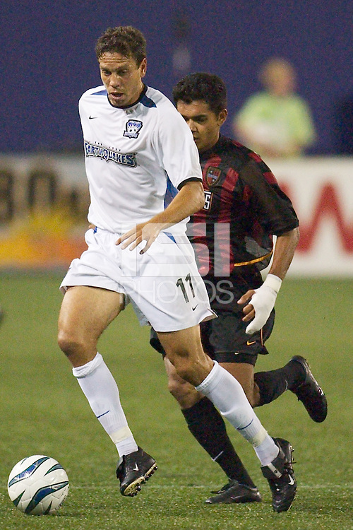 Manny Lagos of the Earthquakes being marked by Amado Guevara of the MetroStars. The San Jose Earthquakes and the the NY/NJ MetroStars played to a 4-4 tie on 7/02/03 at Giant's Stadium, NJ..
