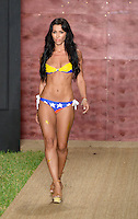 Metisha LaRocca walks runway at Wet Couture Swimwear Show during Funkshion Fashion Week Miami Beach Swim 2013 at Miami Beach, FL on July 18, 2012