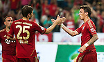 GUANGZHOU, GUANGDONG - JULY 26:  Mario Mandzukic of Bayern Munich is congratulated by Thomas Muller after scoring during a friendly match against VfL Wolfsburg as part of the Audi Football Summit 2012 on July 26, 2012 at the Guangdong Olympic Sports Center in Guangzhou, China. Photo by Victor Fraile / The Power of Sport Images