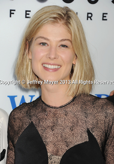 HOLLYWOOD, CA- AUGUST 21: Actress Rosamund Pike arrives at the Los Angeles premiere of 'The World's End' at ArcLight Cinemas Cinerama Dome on August 21, 2013 in Hollywood, California.