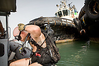 US Navy Seal diver searches for explosives, fearing an attack on the only US base in Africa. On his upper body is tattooed the Psalm 23 of the Bible...The geostrategical and geopolitical importance of the Republic of Djibouti, located on the Horn of Africa, by the Red Sea and the Gulf of Aden, and bordered by Eritrea, Ethiopia and Somalia.